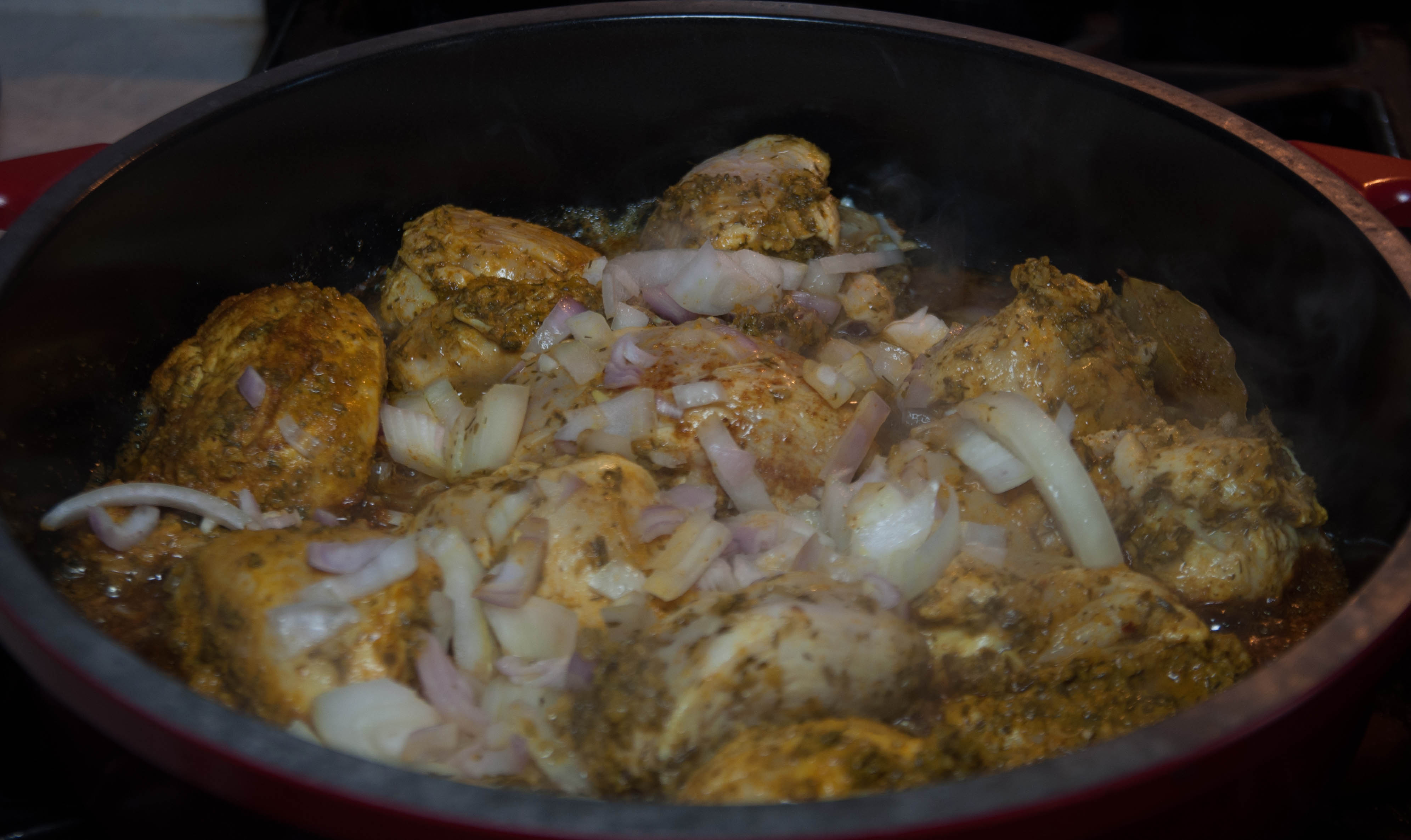 Trini Curry Chicken cooking in pot